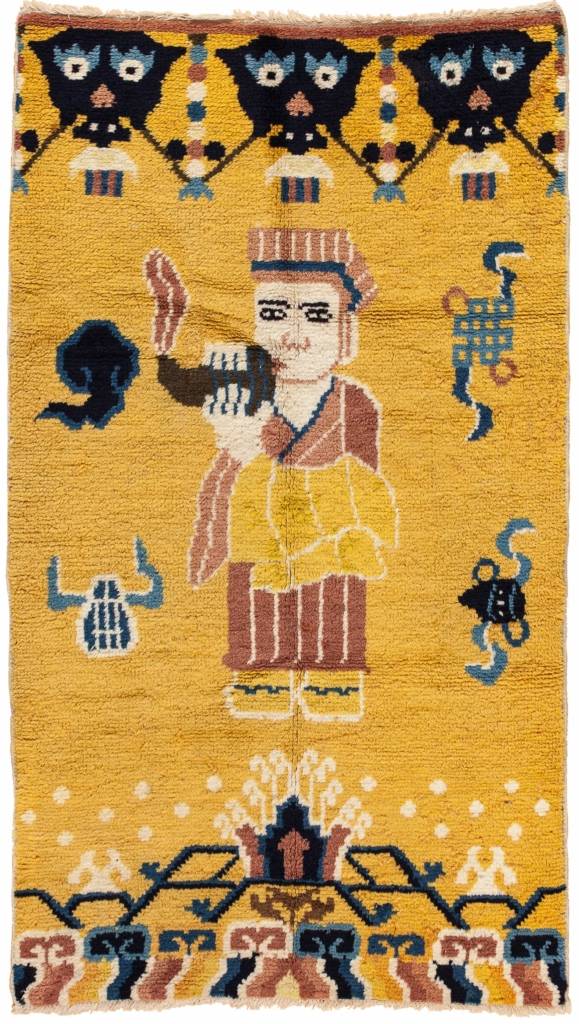 'Robed Lama blows conch' Wool Yellow Pillar Pictorial Rug (one of pair)