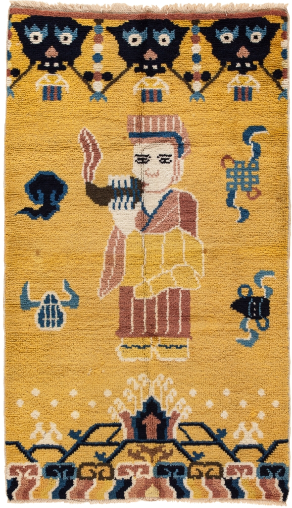 Buddhist Temple Pillar Pictorial Yellow Wool Rug 'Robed Lama blows conch in call to prayer' Early 20th Century 1.5x1m (5x3ft Standard Area Size)