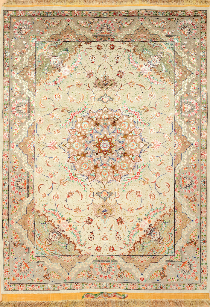 Fine Pure Silk Persian Tabriz Rug - Central Medallion - Light complexion on pistachio green coloured base complemented by blue, pink and ivory accents